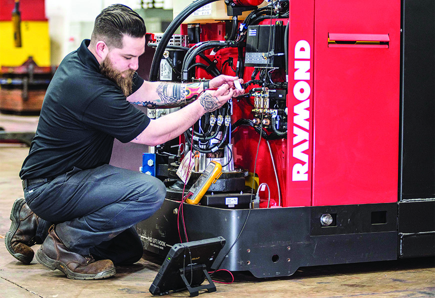 Service-technician-repairing-forklift