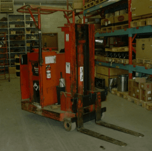 Old-forklift-in-warehouse