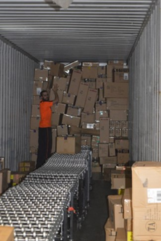 Worker-empties-shipping container